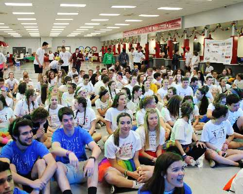 high school students sit on floor for minithon event.