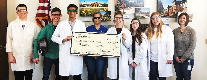 Dart Foundation Presents Check to Warwick Science Department